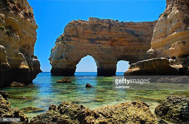 Famous Rock arches in Praia Marinha beach