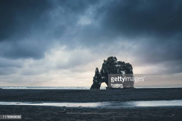 famous rock hvitserkur in iceland - rock formation stock pictures, royalty-free photos & images