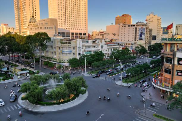 Famous roundabout --Nguyen Hue-- in front of the Hotel Caravelle and Rex Hotel, Ho Chi Minh City, Saigon, Vietnam, Southeast Asia