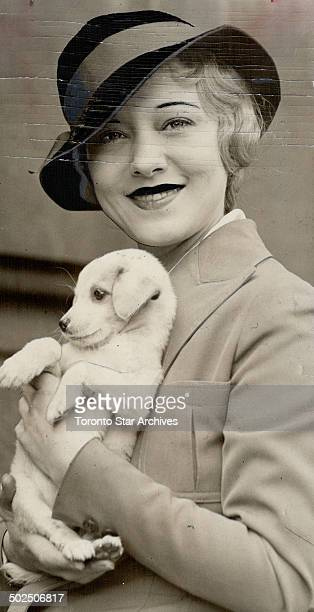 Famous Sally Rand fan dancer here with dog Mamie Looking like a demure slight schoolgirl with blonde hair bluegray eyes a religious education an...