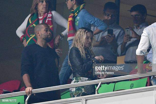 A famous singer Madonna watches the FIFA 2018 World Cup Qualifier between Portugal and Switzerland at the Luz Stadium on October 10 2017 in Lisbon...