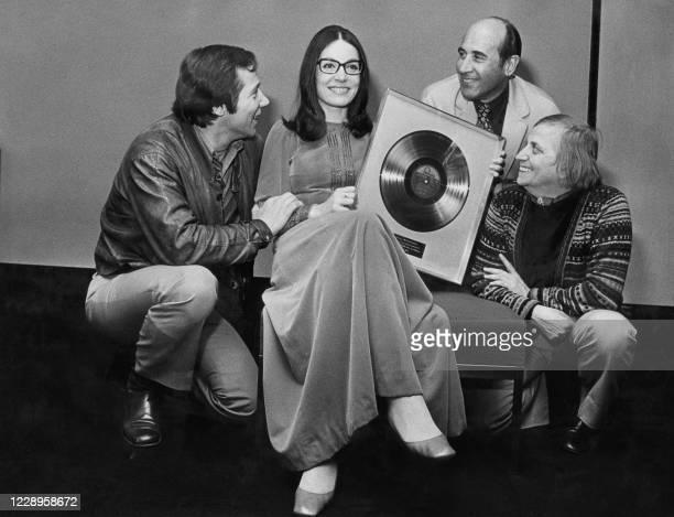 Famous singer Nana Mouskouri's latina record is admired by some wellknown Dutch artists: Piet Romer , Paul Deen and Leen Jongewaard 10 April 1972 in...
