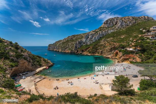 famous small cove in the mediterranean litoral of spain with turquoise water. cala granadella, jávea, region of valencia, spain - valencia spain stock pictures, royalty-free photos & images