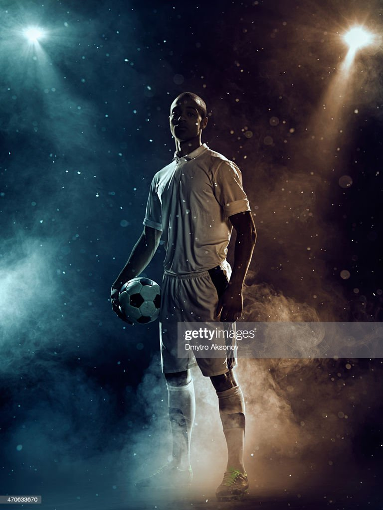 Famous soccer player under highlights : Stock Photo