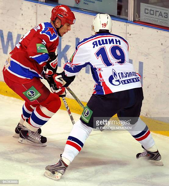 Famous Soviet former NHL Detroit Red Wings' defender Viacheslav Fetisov of CSKA fights for the puck with Alexey Yashin of SKA St Petersburg during...