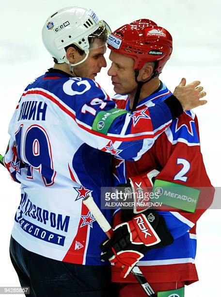 Famous Soviet former NHL Detroit Red Wings' defender Viacheslav Fetisov of CSKA is congratulated after the game with SKA St Petersburg by Alexey...