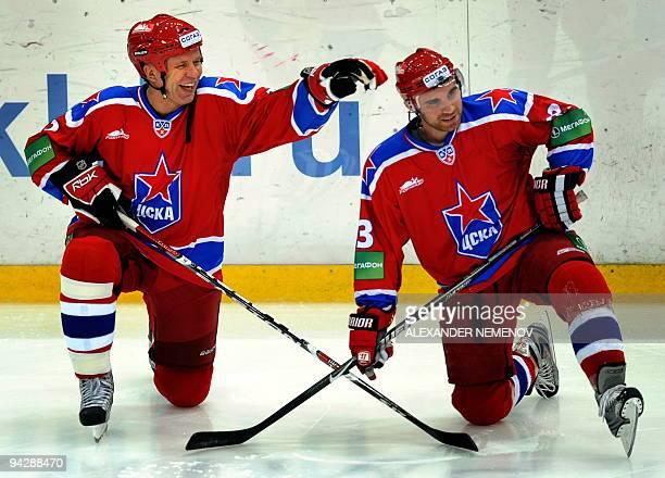 Famous Soviet former NHL Detroit Red Wings' defender Viacheslav Fetisov of CSKA jokes with his teammate Nicolas Dimitrakos prior to the game against...