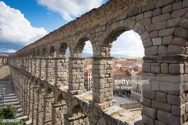 Famous spectacular Roman aqueduct built of granite blocks and Plaza del Azoguejo Segovia Spain