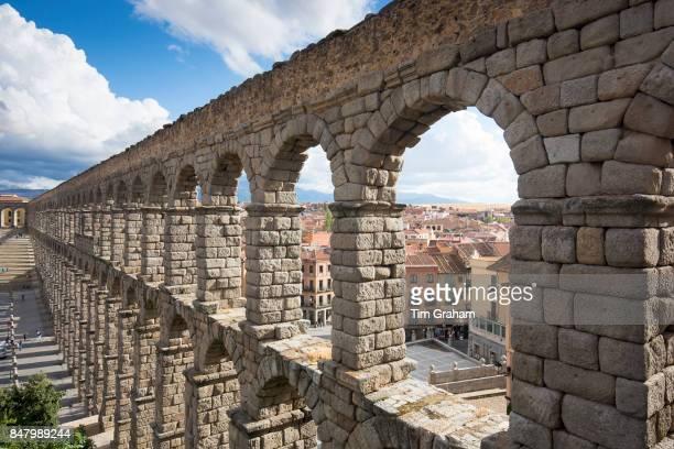 Famous spectacular Roman aqueduct built of granite blocks and Plaza del Azoguejo Segovia Spain