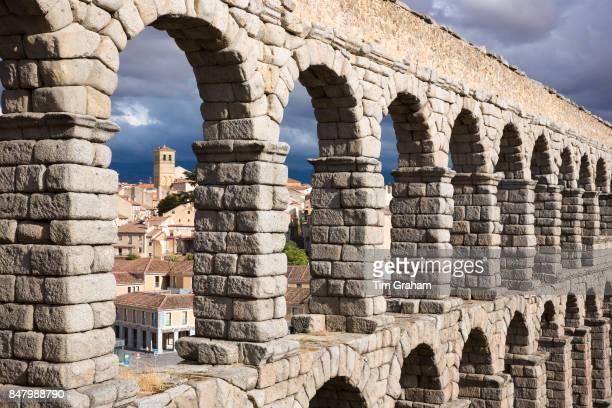 Famous spectacular Roman aqueduct built of granite blocks by Plaza del Azoguejo Segovia Spain