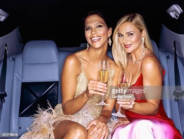 famous, successful women celebrating in limousine - 30代の女性だけ ストックフォトと画像