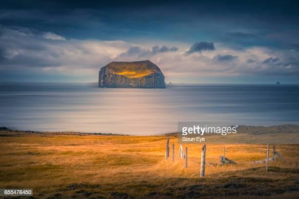 Famous Suðurey Island with a hunting cabin in southern Iceland seen from Stórhöfði on Heimaey Island.