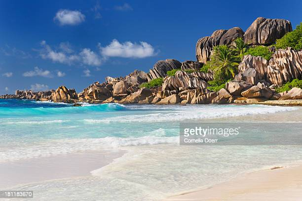 famous tropical beach of anse source d'argent - la digue island stock pictures, royalty-free photos & images