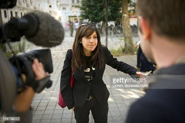 Famous Tunisian blogger Lina Ben Mhenni adresses journalists on Bourguiba avenue in tunis on October 20 days before a historic national election in...