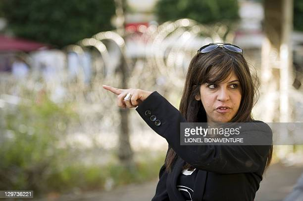 Famous Tunisian blogger Lina Ben Mhenni is seen on Bourguiba avenue in tunis on October 20 days before a historic national election in Tunisia Arab...