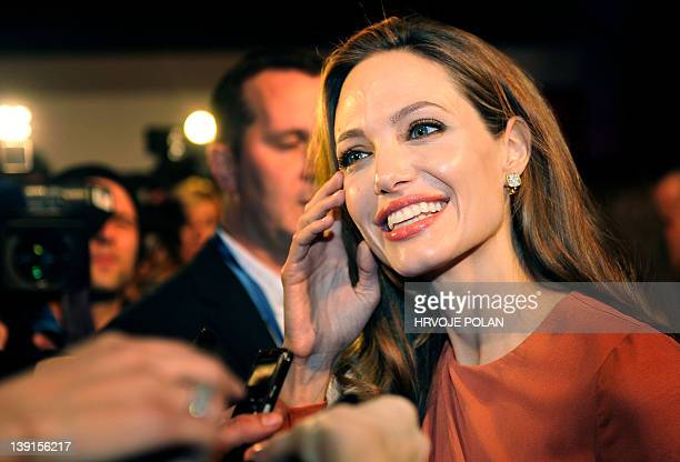 """Famous US actress and director Angelina Jolie answers journalists' questions before the premiere of her film """"In the Land of Blood and Honey"""" in the..."""