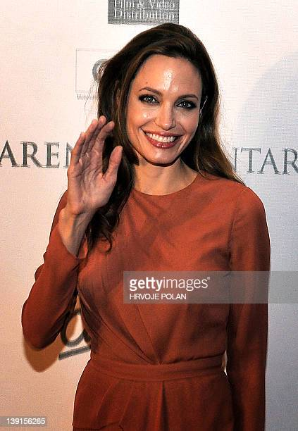 """Famous US actress and director Angelina Jolie poses for a photograph before the premiere of her film """"In the Land of Blood and Honey"""" in the Croatian..."""