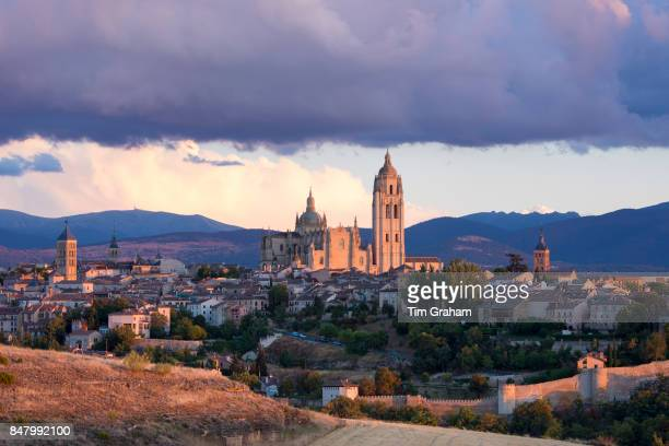 Famous view of Alcazar Castle palace and fortress which inspired Disney castle Cathedral and dramatic sky Segovia Spain