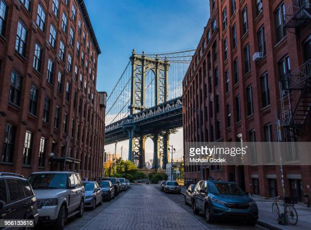 famous view of manhattan bridge from dumbo in early morning - dumbo stock pictures, royalty-free photos & images