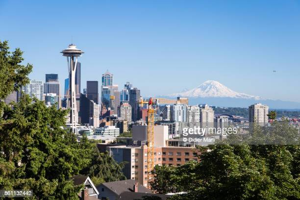 famous view of seattle skyline with the space needle and mt rainier - washington state stock pictures, royalty-free photos & images