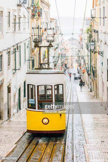 Famous yellow funicular Elevador da Bica in Bairro Alto, Lisbon, Portugal
