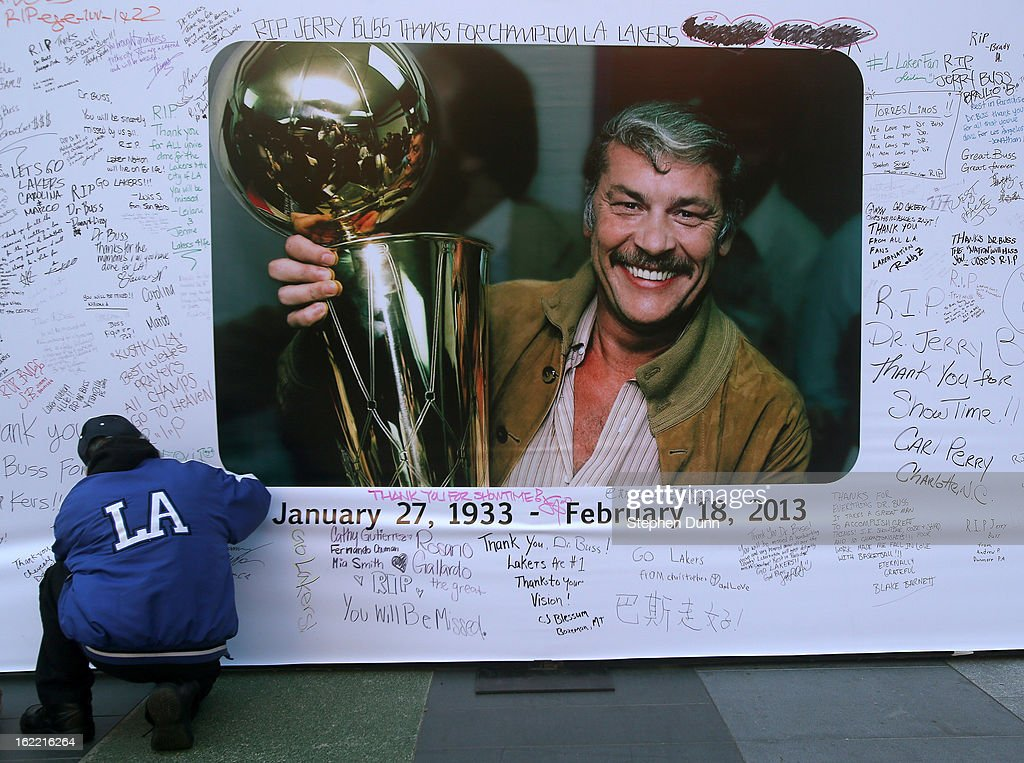 A fan adds his wishes to a wall near Staples Center in honor of the late Dr. Jerry Buss, owner of the Los Angeles Lakers, before the game against the Boston Celtics on February 20, 2013 in Los Angeles, California.
