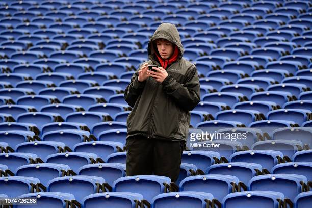 Fan amid empty seats çchecks his phone during the Duke Blue Devils' football game against the Wake Forest Demon Deacons at Wallace Wade Stadium on...