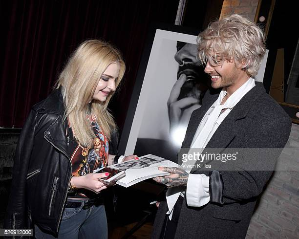 A fan and BILLY attends BILLY Love Don't Break Me Art Exhibit book launch and shortfilm screening on April 29 2016 in Los Angeles California