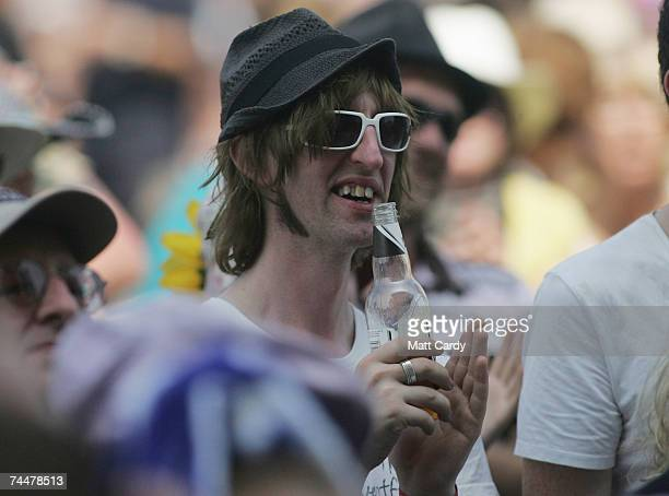 A fan applauds as he watches Donovan perform on the second day of the Isle of Wight Festival 2007 at Seaclose Park in Newport June 9 2007 on the Isle...