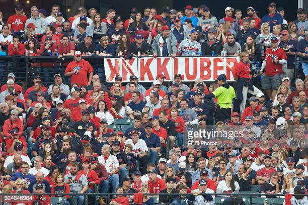 Fan are seen holding up a sign for Corey Kluber of the Cleveland Indians during Game 2 of the ALDS against the New York Yankees at Progressive Field...
