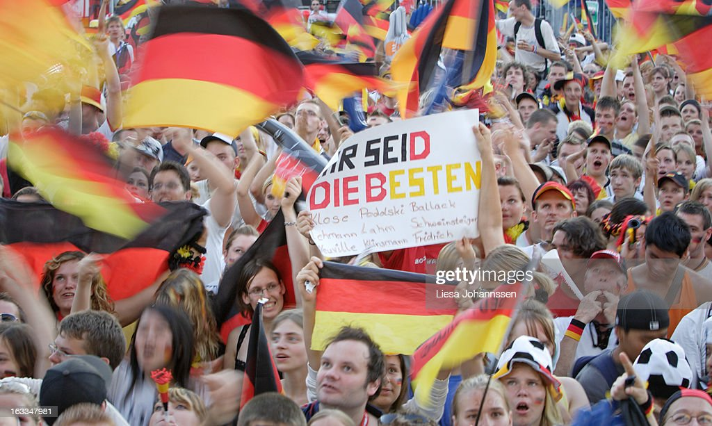 'Fan area in Berlin during the FIFA World Cup 2006, International Soccer Tournament, Crowd watching the German Team, Men and Women bellowing and swinging flags, Holding a sign with lettering'' You are the best'', July 05, 2006, Berlin , Germany. (Photo by Liesa Johannssen/Photothek via Getty Images)'