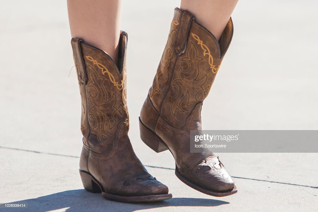 size 7 hot sale online check out A TCU fan arrive in traditional cowboy boots before the game ...
