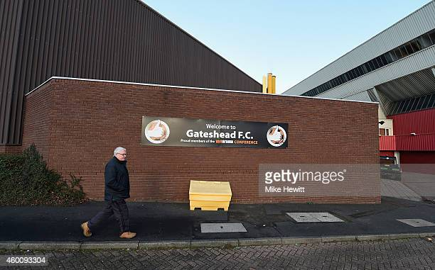 A fan arrives for the FA Cup Second Round tie between at Gateshead FC v and Warrington Town on December 7 2014 in Gateshead England