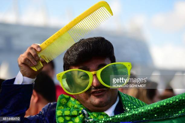 A fan arrives to attend the round of 16 football match between Costa Rica and Greece at Pernambuco Arena in Recife during the 2014 FIFA World Cup on...