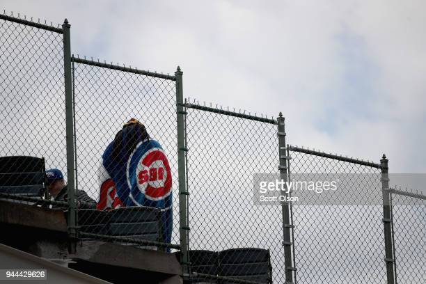 A fan at Wrigley Field waits for the start of the Chicago Cubs home opener on April 10 2018 in Chicago Illinois The game against the Pittsburgh...