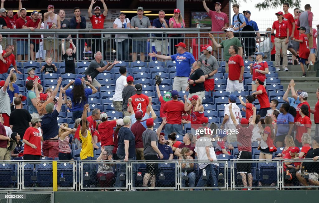 A fan attempts to catch a home run ball off the bat of Nick Williams of the Philadelphia Phillies in the eighth inning during a game against the Toronto Blue Jays at Citizens Bank Park on May 26, 2018 in Philadelphia, Pennsylvania. The Phillies won 2-1.