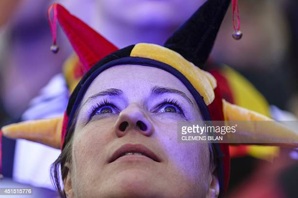 A fan attends a public viewing ahead of the FIFA World Cup 2014 Round of 16 football match between Germany and Algeria on a giant screen in Berlin...