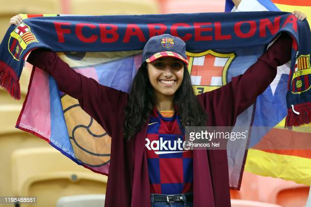 Fan attends the Supercopa de Espana Semi-Final match between FC Barcelona and Club Atletico de Madrid at King Abdullah Sports City on January 09,...