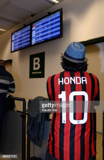 Fan awaits the arrival of AC Milan's new signing Keisuke Honda is seen upon arrival at Milano Malpensa Airport on January 4 2014 in Milan Italy