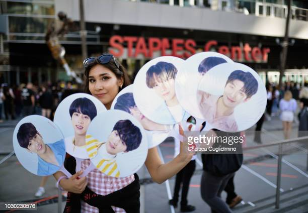 A fan awaits the BTS concert as part of the Love Yourself North American Tour at Staples Center on September 9 2018 in Los Angeles California