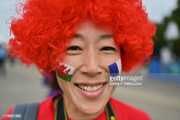 A fan awaits the start of the Japan 2019 Rugby World Cup quarterfinal match between Wales and France at the Oita Stadium in Oita on October 20 2019