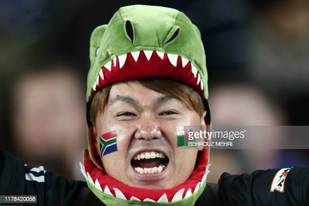TOPSHOT A fan awaits the start of the Japan 2019 Rugby World Cup semifinal match between Wales and South Africa at the International Stadium Yokohama...