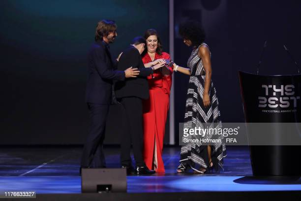 Fan Award Winner Nickollas Grecco and his mother Silvia Grecco receives the award from FIFA Legends Laura Georges of Bayern Munich and France and...