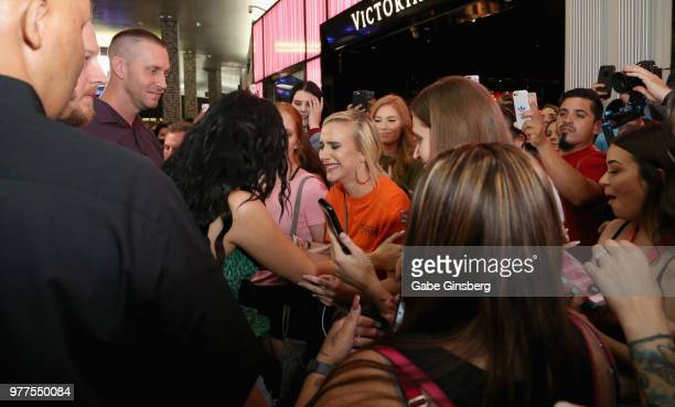 A fan begins to cry after meeting YouTube personality Jaclyn Hill during Morphe store opening at the Miracle Mile Shops at Planet Hollywood Resort...