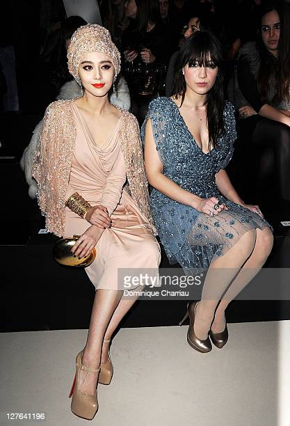 Fan Bing Bing and Daisy Lowe pose as they attend the Elie Saab Ready to Wear Autumn/Winter 2011/2012 show during Paris Fashion Week at Espace...
