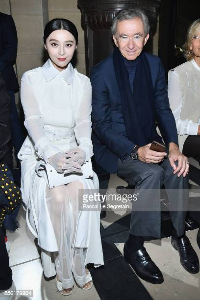 Fan Bingbing and Bernard Arnault attend the Givenchy show as part of the Paris Fashion Week Womenswear Spring/Summer 2018 on October 1 2017 in Paris...