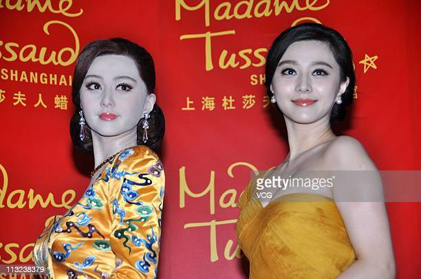 Fan Bingbing poses with her new wax figure at Shanghai Madame Tussauds on April 28, 2011 in Shanghai, China.