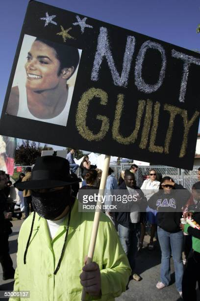 Fan BJ Hickman dressed in a Michael Jackson outfit shows his support for the US pop outside Santa Barbara County Superior Court in Santa Maria...