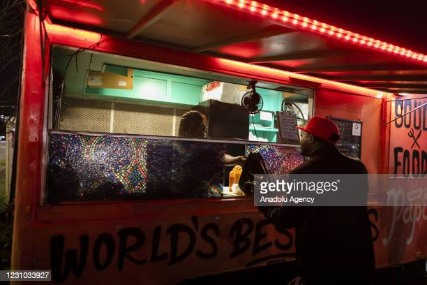 Fan buys food in a food truck outside Raymond James Stadium during Super Bowl LV, in Tampa, Florida, United States on February 07, 2021.