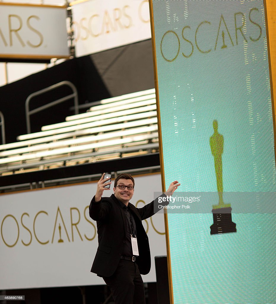 A fan can't resist taking a selfie on the Oscars red carpet at Hollywood & Highland Center on February 19, 2015 in Hollywood, California.